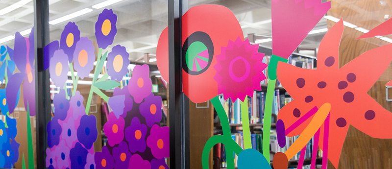 Painted flowers on glass doors to library