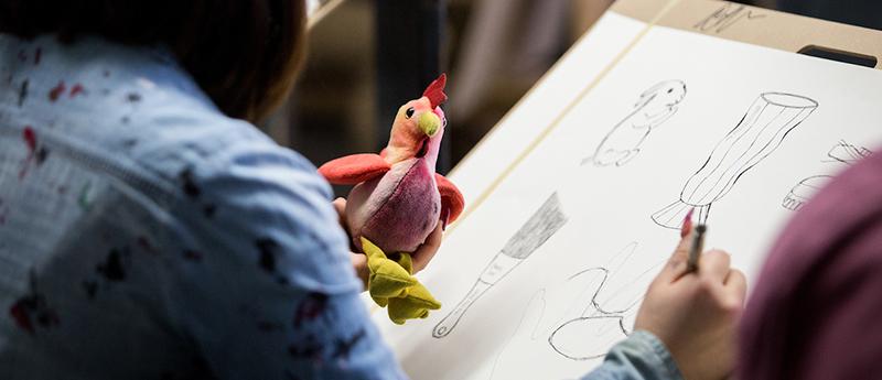 Student sketches stuffed bird