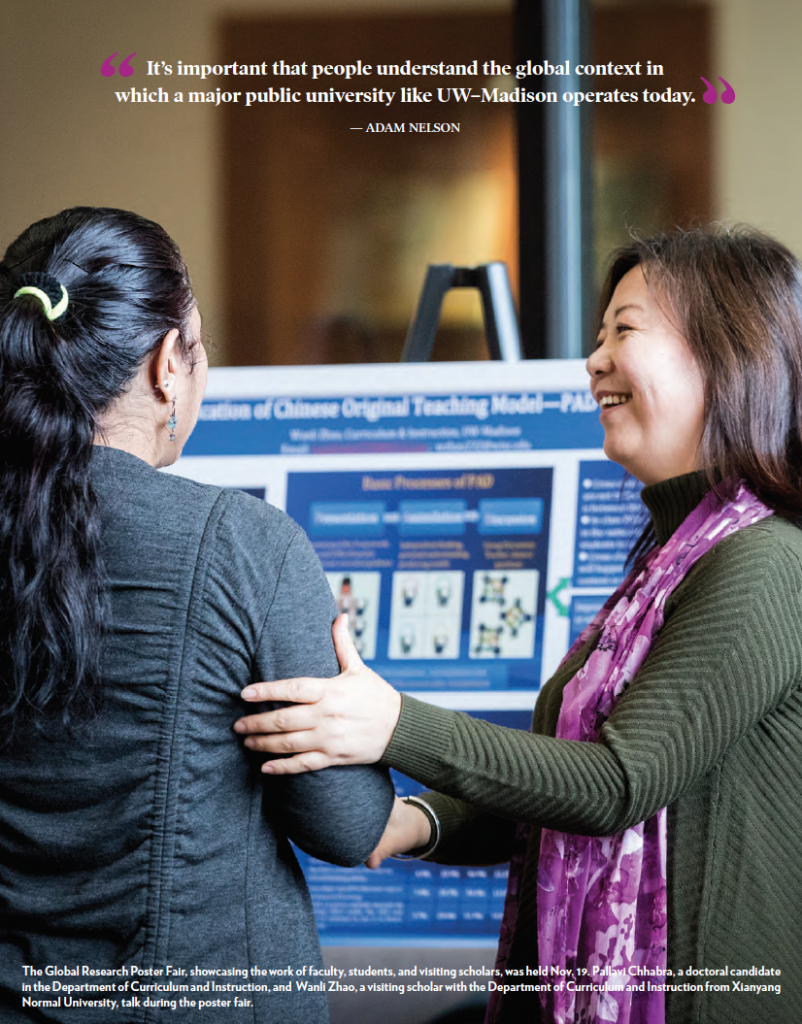 """two people at a research fair with text quote """"its important that people understand that global context in which a major public university like UW-Madison operates today."""" adam nelson"""