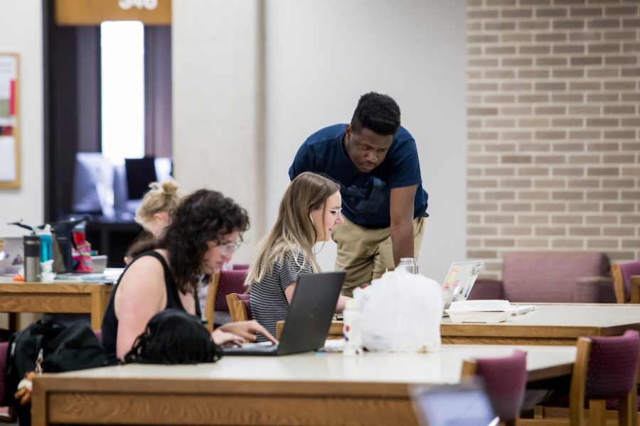 uw madison students studying in merit library