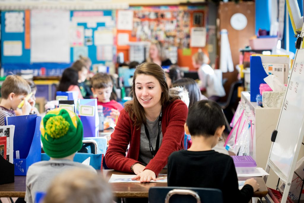 uw madison student teacher in classroom surrounded by students