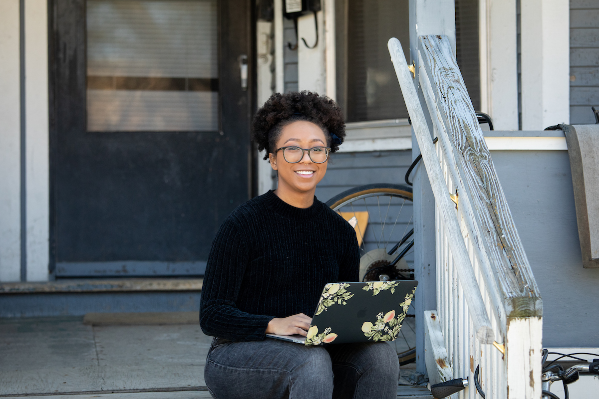 Bri'Anna Collins, a doctoral student in the Department of Educational Psychology's School Psychology program, works from her porch after UW–Madison shifts to online learning due to the COVID-19 pandemic.